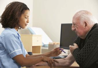 A nurse gives an elderly man an injection