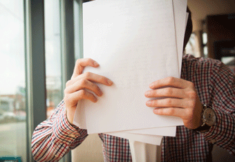 A candidate for a job checks how long their resume is before submitting it.