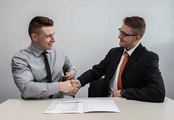 A dedicated, professional employee is promoted by their manager.