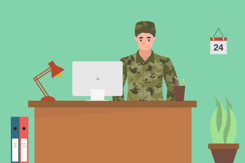 A US military member getting ready to write a resume on a computer