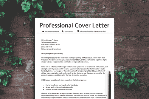 Proper cover letter format set upon a wooden table with leaves